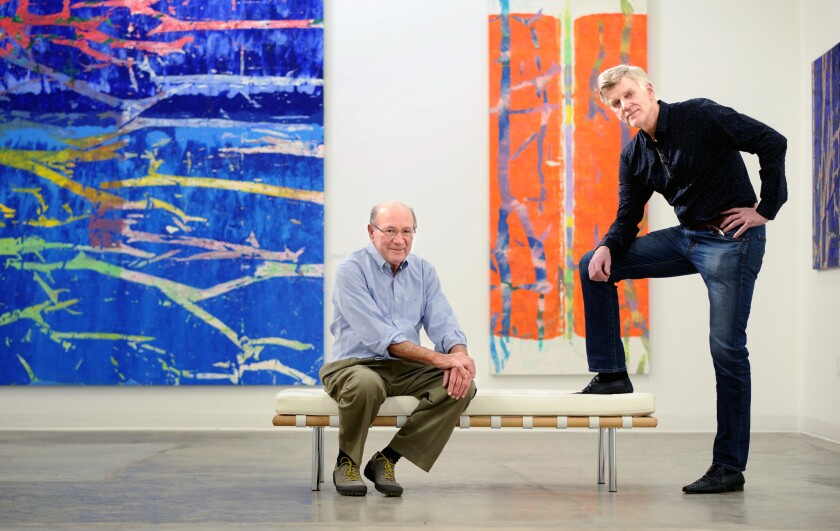 Pedro Cuatrecasas, left, contacted Peter Hastings Falk after finding the paintings of his brother Gil Cuatrecasas. The works are at CB1-G gallery in downtown Los Angeles.
