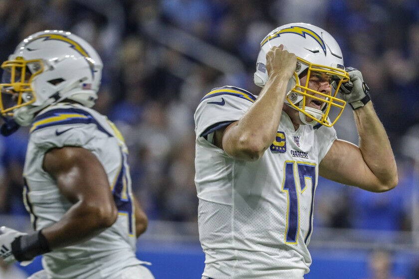 Chargers quarterback Philip Rivers yells at one of his receivers after an apparent miscommunication led to a broken play against the Lions at Ford Field on Sunday.