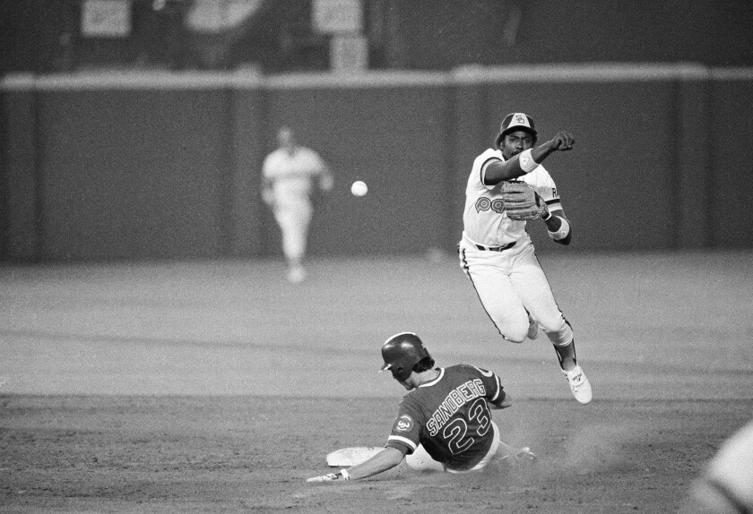 Padres shortstop Garry Templeton throws past Cubs' Ryne Sandberg to complete a double play during Game 4 of the National League Championship Series on Oct. 6, 1984 at San Diego Jack Murphy Stadium.