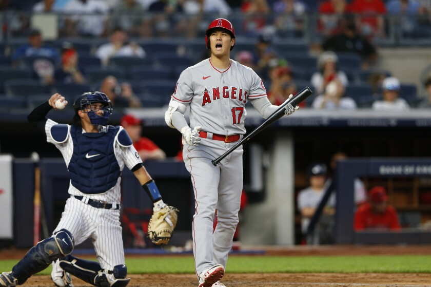Angels designated hitter Shohei Ohtani reacts after a called strike.