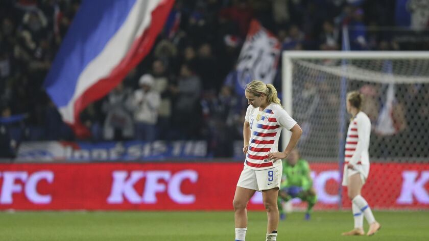 US midfielder Lindsey Horan stands on the pitch after France scored its third goal during a women's