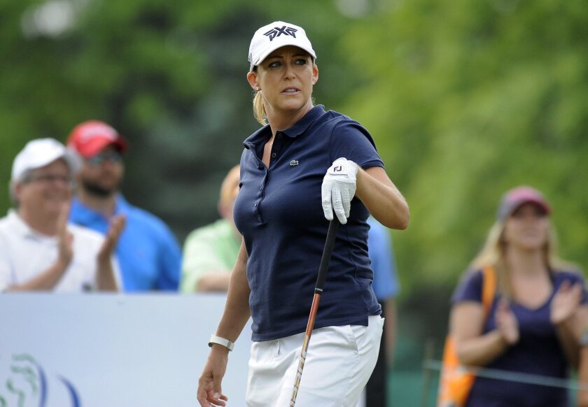 Cristie Kerr watches her shot from the first tee during the final round of the LPGA Volvik Championship golf tournament at the Travis Pointe Country Club, Sunday, May 29, 2016, in Ann Arbor, Mich. (AP Photo/Jose Juarez)