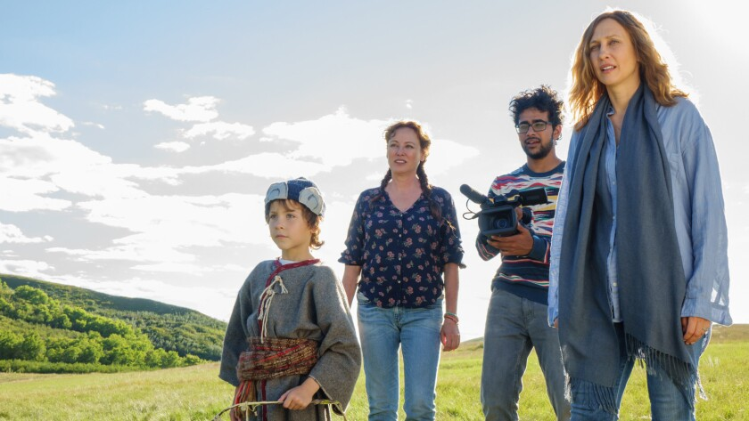 "Jacob Tremblay, from left, Virginia Madsen, Suraj Sharma and Vera Farmiga in the movie ""Burn Your Maps."""