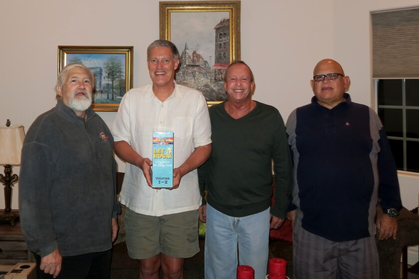 Louis Procaccino (left) is shown with Thomas K. Arnold, Marc Berman and friend Joe Jacoby.