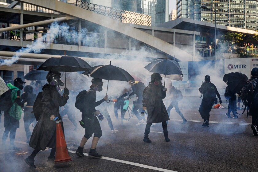 Tear gas canisters fired by Hong Kong police against protesters