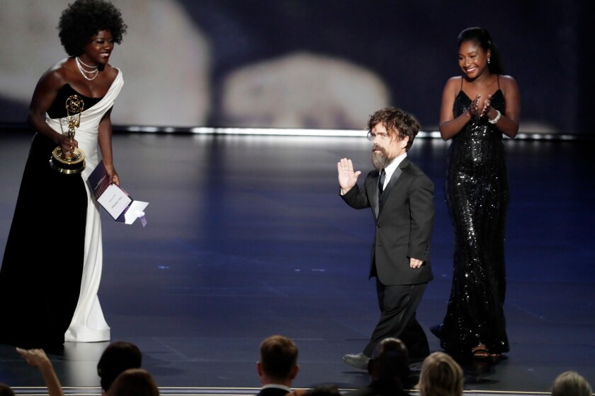 Viola Davis gives Peter Dinklage his Emmy for supporting actor in a drama series at the 71st Primetime Emmy Awards.