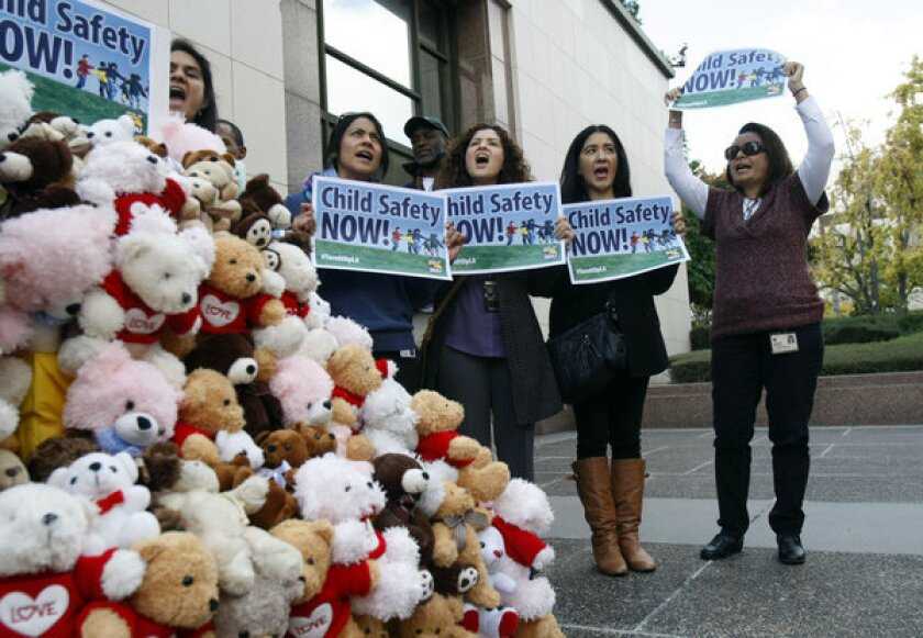 Los Angeles County social workers hold a rally Tuesday in front of the Hall of Administration in downtown Los Angeles to protest their caseloads.