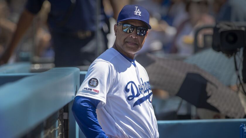 LOS ANGELES, CALIF. -- SUNDAY, JUNE 23, 2019: Dodgers manager Dave Roberts keeps an eye on the team