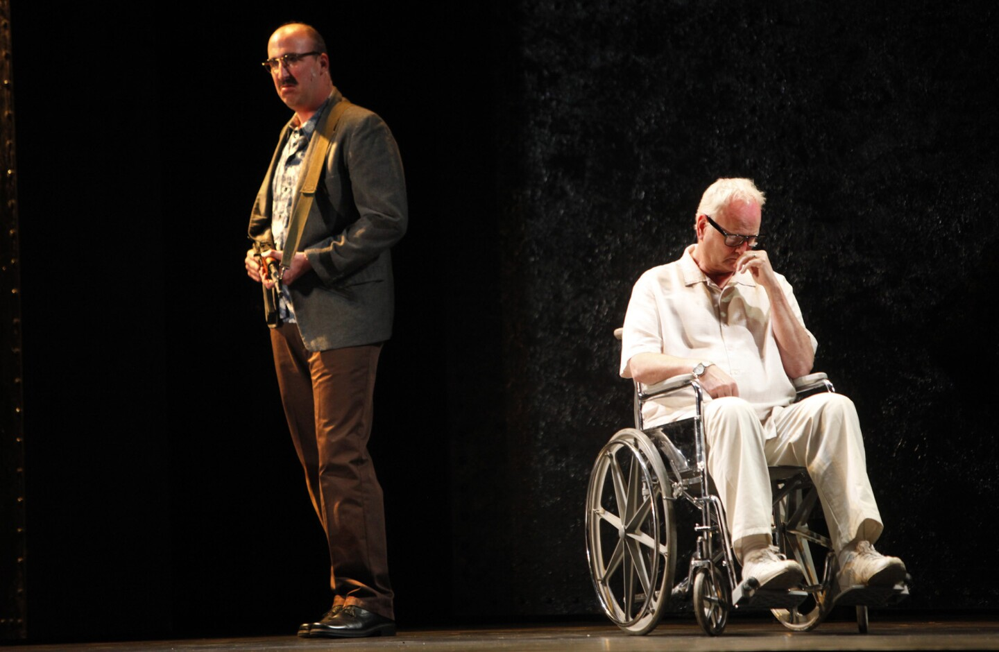 """Jason Switzer, left, portrays terrorist Mamoud and Robin Buck is the title character in Long Beach Opera's """"The Death of Klinghoffer."""""""