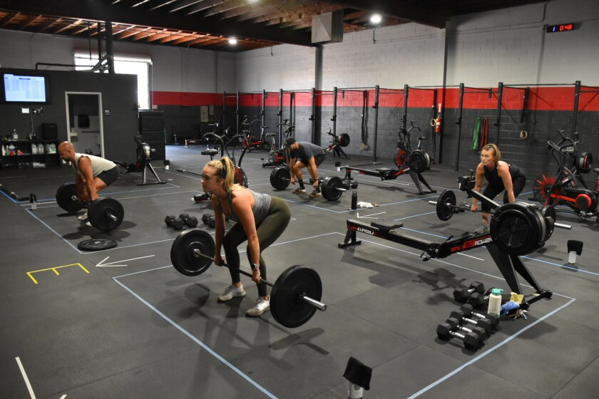 Members of Performance360 in Pacific Beach stay in designated workout zones to practice social distancing.