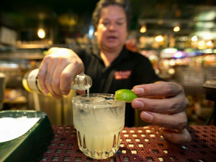 In this Monday, April 28, 2014 photo, bartender Mario Sanchez crafts a margarita cocktail at the bar of El Coyote, a Mexican restaurant in Los Angeles. Thousands of restaurateurs from coast to coast who have fallen victim to the Great Green Citrus Crisis of 2014. The lime has skyrocketed in price i