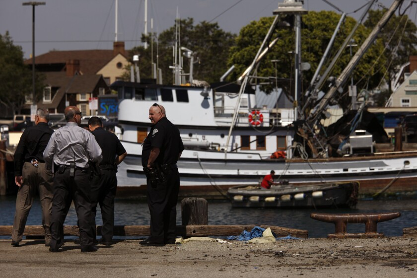 LAPD Harbor Division detectives  and police officers investigate the scene of a crash in 2015 in San Pedro.