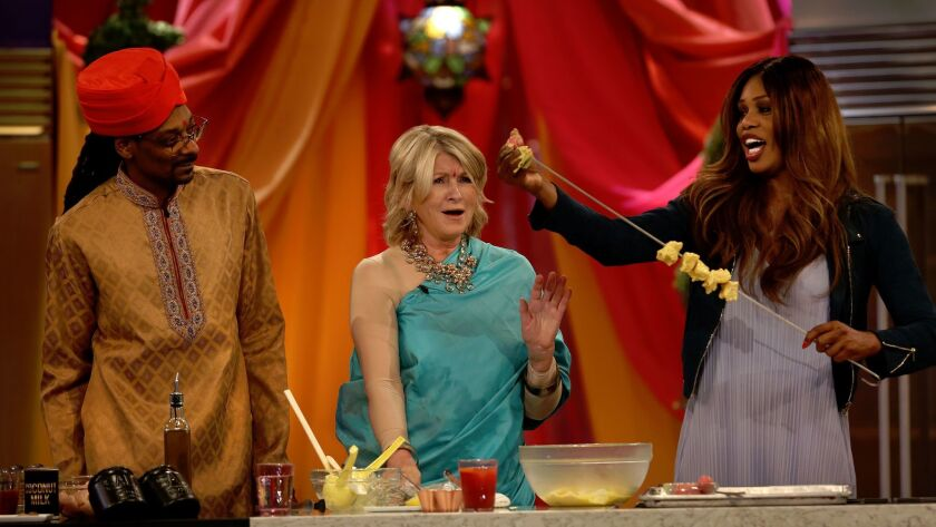 Snoop Dogg and Martha Stewart watch as special guest Laverne Cox puts chicken onto a skewer on VH1's