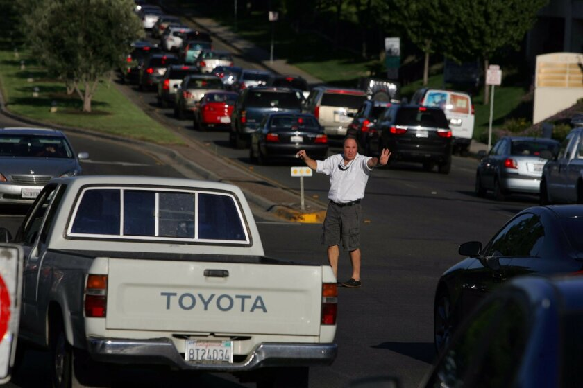 Good Samaritan Dave Eminhizer decided to direct traffic at the intersection of Rancho Bernardo Road and Bernardo Center Drive during a power outage on Thursday in San Diego, California.