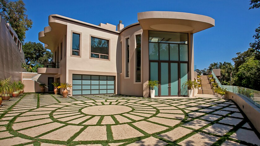 This roughly 11,000-square-foot home in Pacific Palisades was leased in 2014 by pop singer Rihanna.