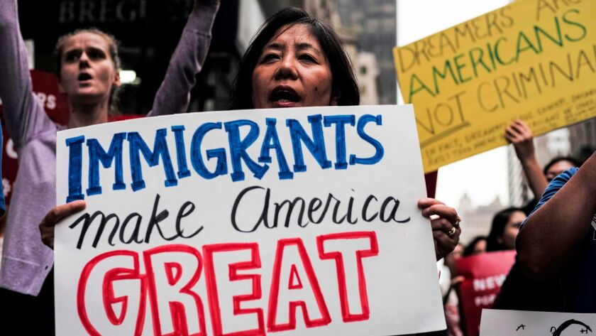 """Protesters in New York City assail President Trump's decision in October to end the Deferred Action for Childhood Arrivals program. On Thursday, the administration outlined a proposal to give """"Dreamers"""" a path to citizenship in exchange for other changes to immigration law."""