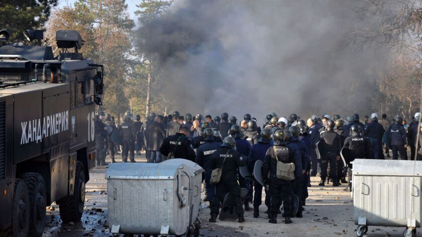Bulgarian riot police stand ready during clashes Nov. 24 in a camp for migrants in the town of Harmanli.