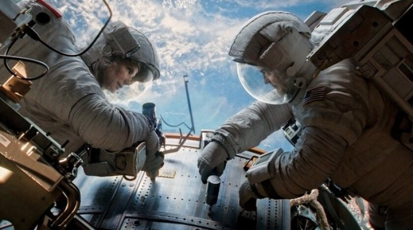 """Actors Sandra Bullock and George Clooney play two space shuttle astronauts who become marooned above Earth in the new movie, """"Gravity."""""""