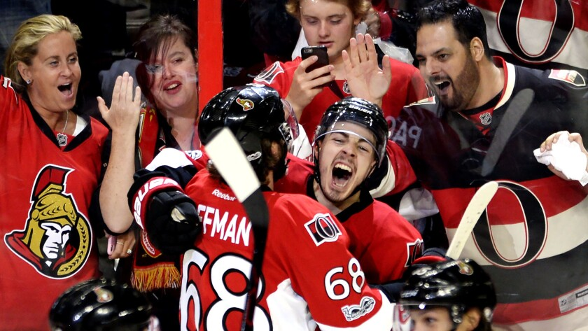 Senators center Jean-Gabriel Pageau celebrates his game-winning goal against the Rangers with left wing Mike Hoffman (68) on Saturday.