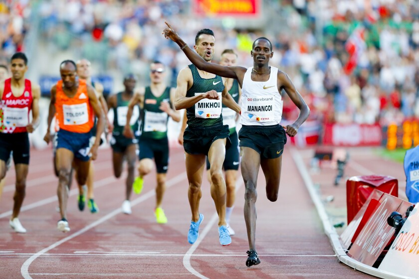 Elijah Motonei Manangoi of Kenya celebrates winning the men's mile race at the 2018 Bislett Games on June 7, 2018 in Oslo, Norway.