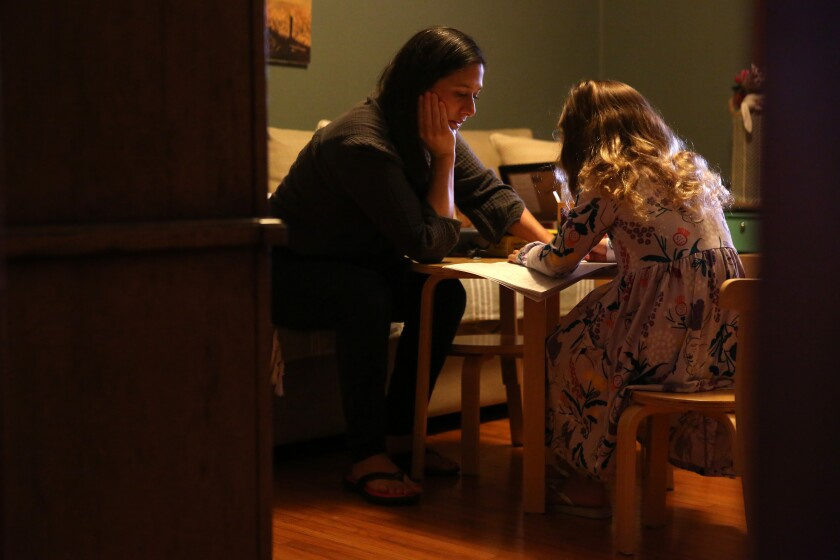 Cindy Carcamo crafts with her 5-year-old daughter at home in Santa Ana