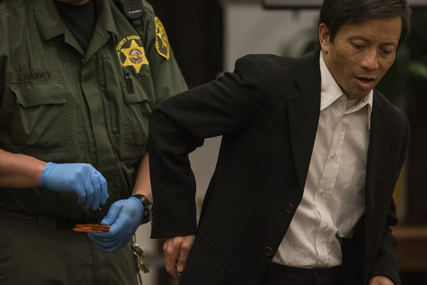 Gianni Anthony Van is released from handcuffs as he arrives at court in Orange County for his murder trial.