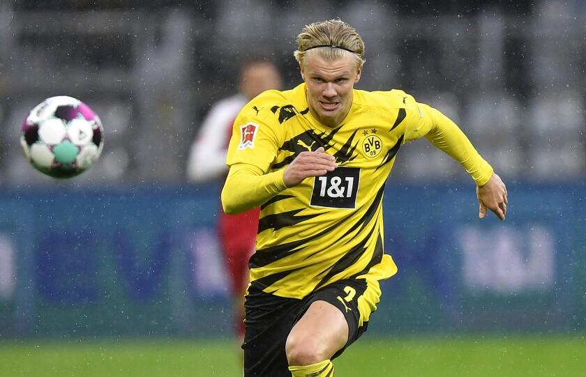 Dortmund's scorer Erling Haaland runs for the ball during the German Bundesliga soccer match between Borussia Dortmund and SC Freiburg in Dortmund, Germany, Saturday, Oct. 3, 2020. (AP Photo/Martin Meissner)
