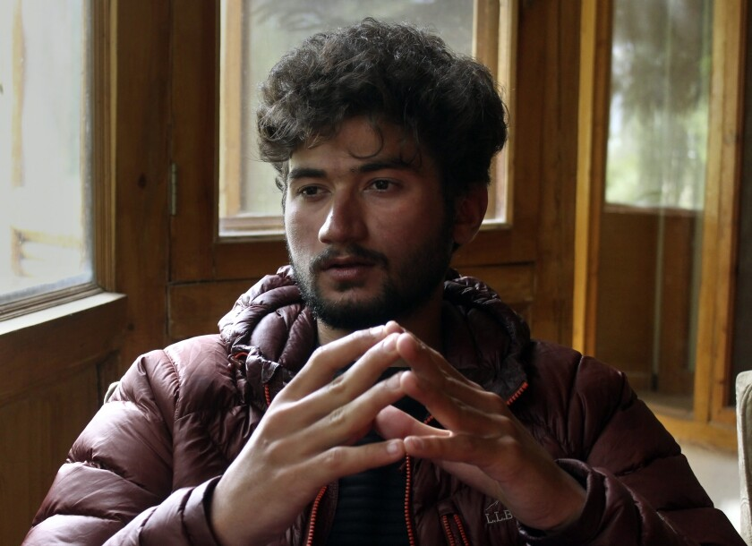 """Pakistani mountain climber Shehroz Kashif, 19, gives an interview to The Associated Press, in Skardu, a town in the Gilgit Baltistan region of northern Pakistan, Sunday, Aug. 1, 2021. The young mountaineer who last week scaled the second-highest mountain on earth, said Sunday he felt a """"sense of achievement"""" as he stood atop the K2 summit and hoisted the Pakistani flag. (AP Photo/M.H. Balti)"""