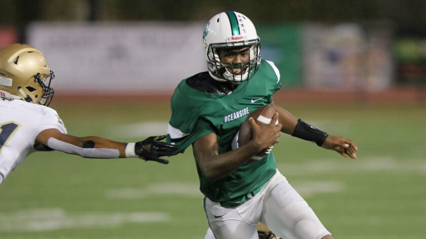 Oceanside quarterback Kyrin Beachem (shown in an earlier game) sparked the Pirates to a win over rival El Camino on Friday.