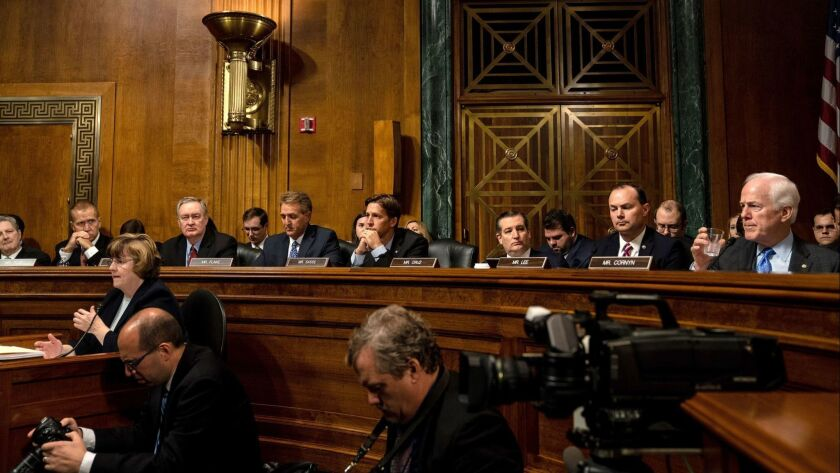 Senate Judiciary Committee Republicans listen during a hearing on Sept. 27.