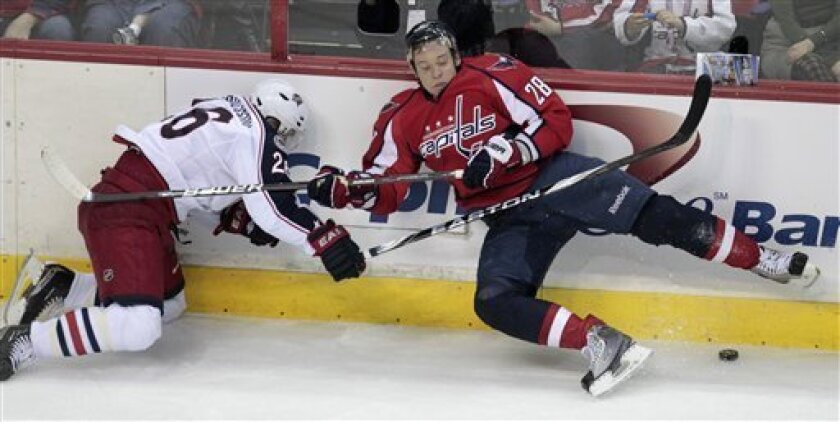 Columbus Blue Jackets' Samuel Pahlsson, left, of Sweden, and Washington Capitals' Alexander Semin (28), of Russia,  battle for the puck during the first period of an NHL hockey game Thursday, March 31, 2011, in Washington. ( AP Photo/Luis M. Alvarez)