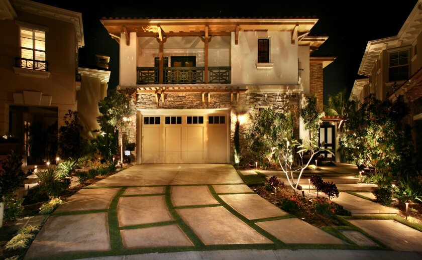 Warm white light from various light sources creates a safe, welcoming entry to this home.
