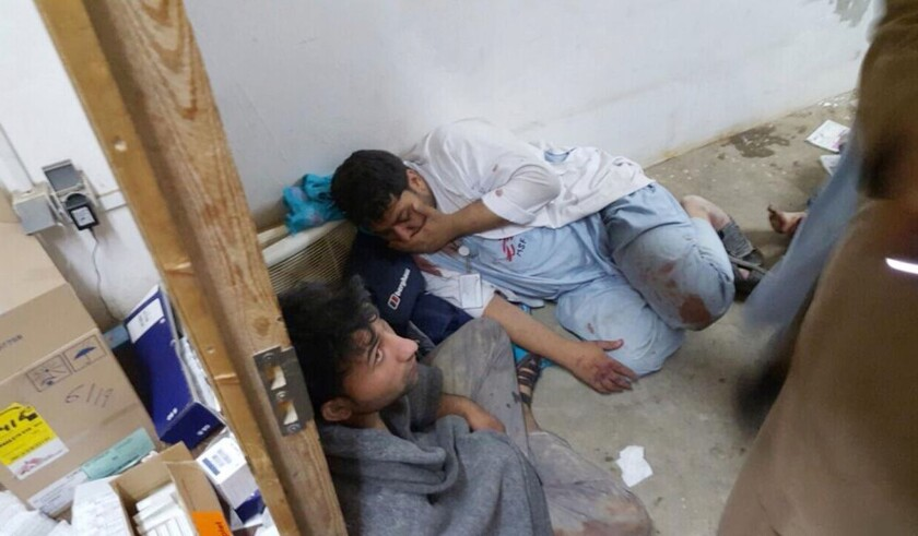 Injured Doctors Without Borders staff are seen after explosions near their hospital in the northern Afghan city of Kunduz.