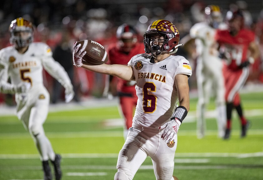 Estancia's Noah Aires celebrates after scoring a touchdown in the first half of nonleague game against Artesia on Thursday.