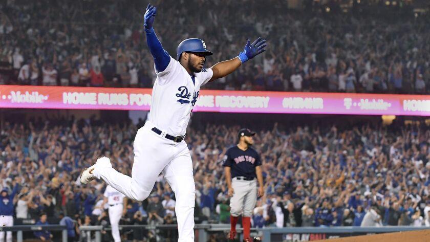 LOS ANGELES, CALIFORNIA , OCTOBER 27, 2018-Dodgers Yasiel Puig hits a three-run home run against the
