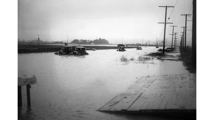 Cars stalled on a flooded Culver City street circa 1920. No other information available on this imag