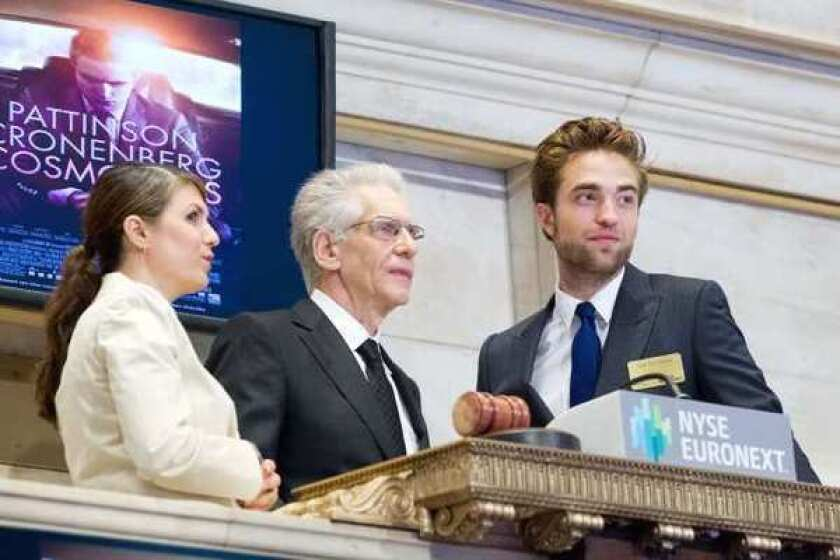 """Robert Pattinson and David Cronenberg ring the opening bell at NYSE to promote their upcoming film, """"Cosmopolis."""""""