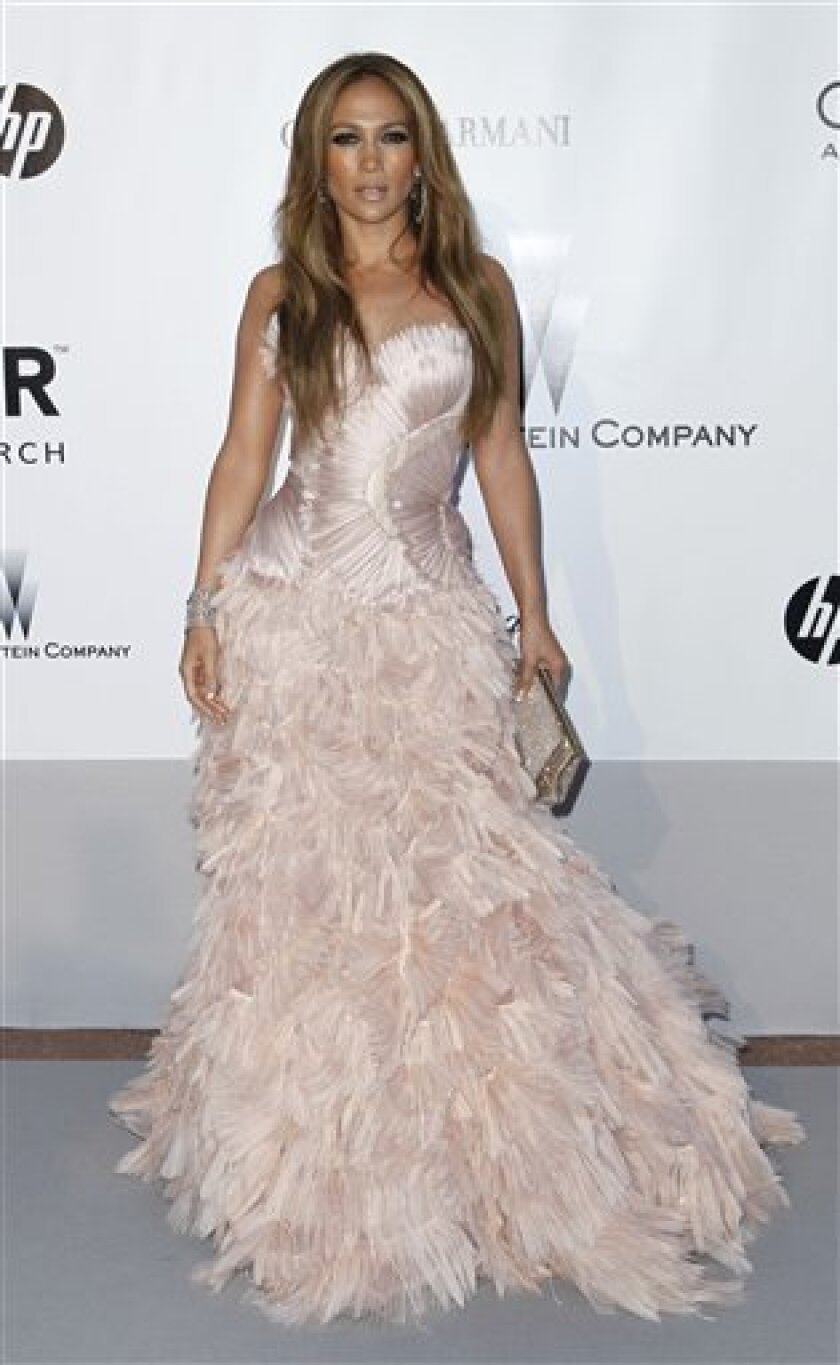 Actress Jennifer Lopez arrives for the amfAR Cinema Against AIDS benefit at the Hotel du Cap-Eden-Roc, during the 63rd Cannes international film festival, in Cap d'Antibes, southern France Thursday, May 20, 2010.  (AP Photo/Matt Sayles)
