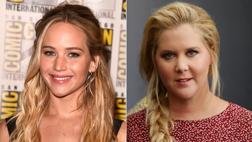 Actresses Jennifer Lawrence, left, and Amy Schumer are working on a screenplay together.
