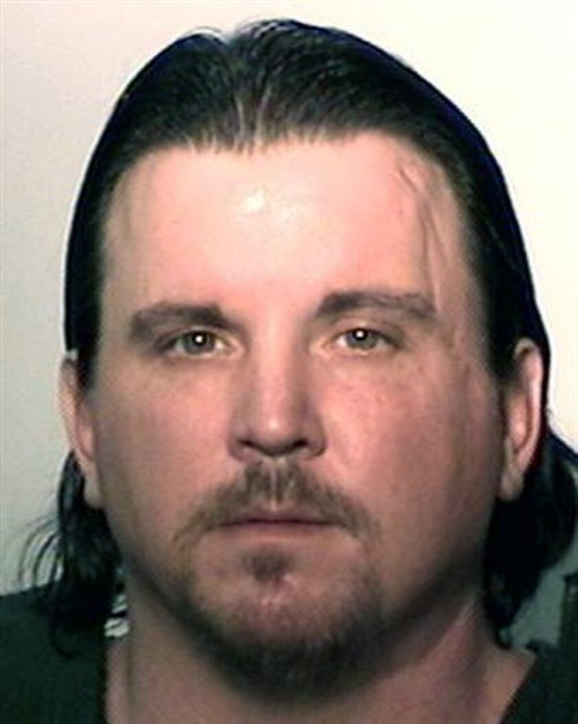 FILE - In this undated file photo provided by the Allen County (Ind.) Sheriff's Dept., Michael Plumadore is shown. Allen Superior Court Magistrate Samuel Keirns entered a not guilty plea Wednesday, Jan. 4, 2012, for the 39-year-old man accused of killing and dismembering 9-year-old Aliahna Maroney-Lemmon and hiding some of her remains in his trailer. Plumadore was charged Friday, Dec. 30, 2011, with murder, abuse of a corpse and removing a dead body from the scene in the Dec. 22 death of Maroney-Lemmon. Relatives say they had considered Plumadore a trusted family friend. (AP Photo/Allen County Sheriff's Department, File)