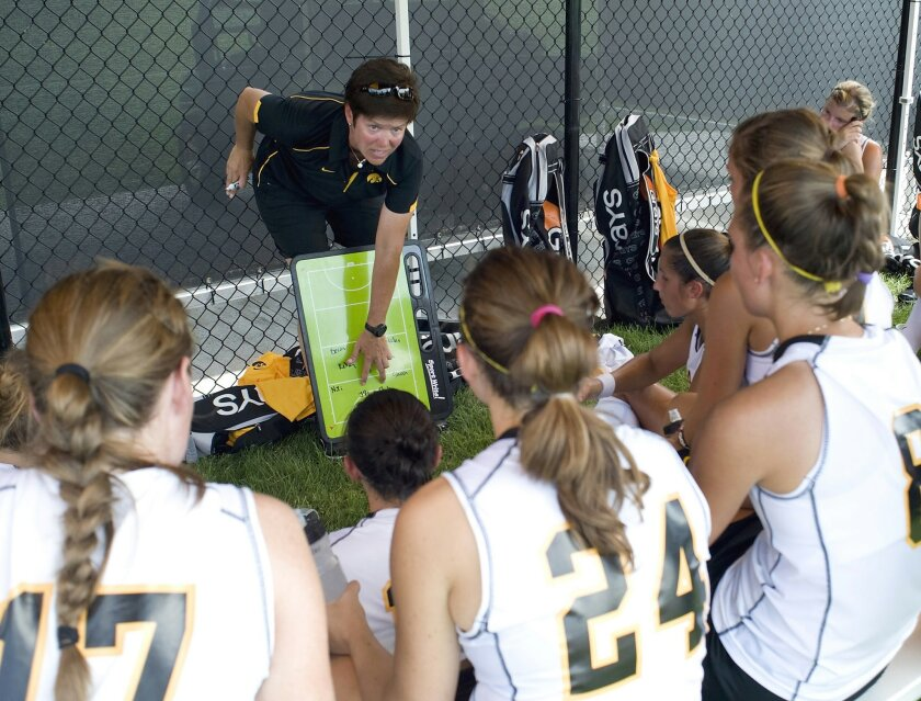 FILE - In this file photo provided by the University of Iowa athletics department, Hawkeyes women's field hockey coach Tracey Griesbaum works on a play with the team. The University of Iowa is refusing to reinstate Griesbaum or to investigate what her supporters call a pattern of unfair treatment of female coaches, according to correspondence obtained by The Associated Press. Griesbaum was fired after some ex-players alleged she verbally abused and bullied them. (AP Photo/University of Iowa, File)