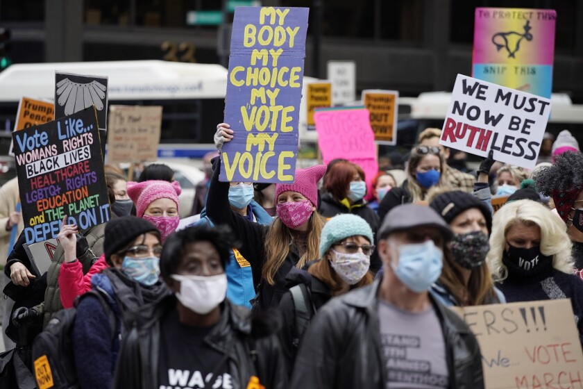 People march during the Women's March in downtown Chicago, Saturday, Oct. 17, 2020. (AP Photo/Nam Y. Huh)