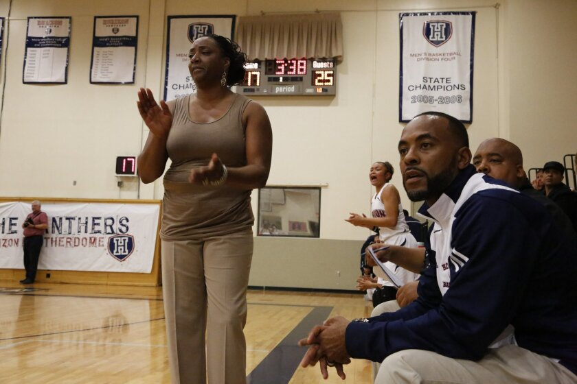 Horizon head girls basketball coach Vickie Carrington and her husband and assistant coach, former Charger Darren Carrington, coach their team from the sidelines against La Jolla Country Day Jan. 25, 2013.