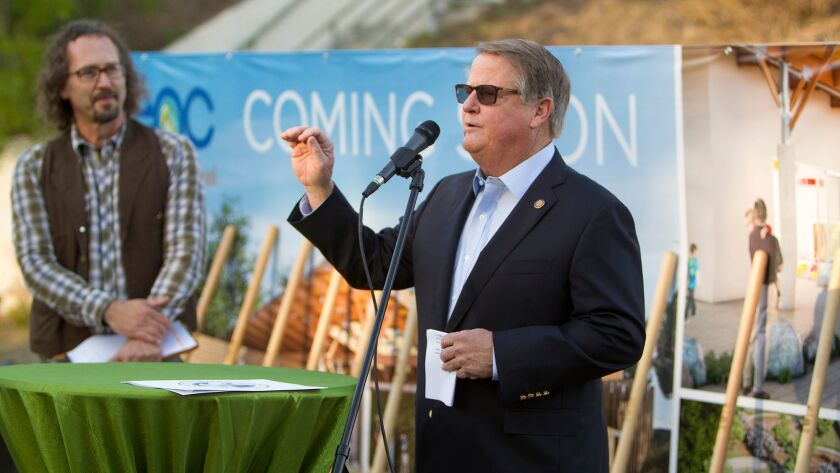 Newport Beach Mayor Mayor Marshall Duffield speaks during a groundbreaking ceremony Thursday for a three-classroom preschool at the Environmental Nature Center in Newport Beach. At left is Bo Glover, the nature center's executive director.