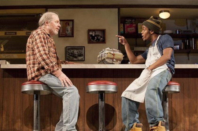"""In this theater publicity image released by Jeffrey Richards Associates, Michael McKean, left, and Jon Michael Hill are shown in a scene from Tracy Letts' """"Superior Donuts,"""" now playing at Broadway's Music Box Theatre in New York. (AP Photo/Jeffrey Richards Associates, Robert J. Saferste)"""