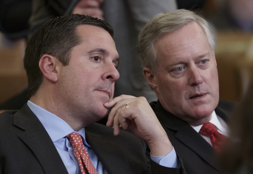 Rep. Devin Nunes, R-Calif, left, speaks with then Rep. Mark Meadows, R-N.C., on Capitol Hill in Washington.