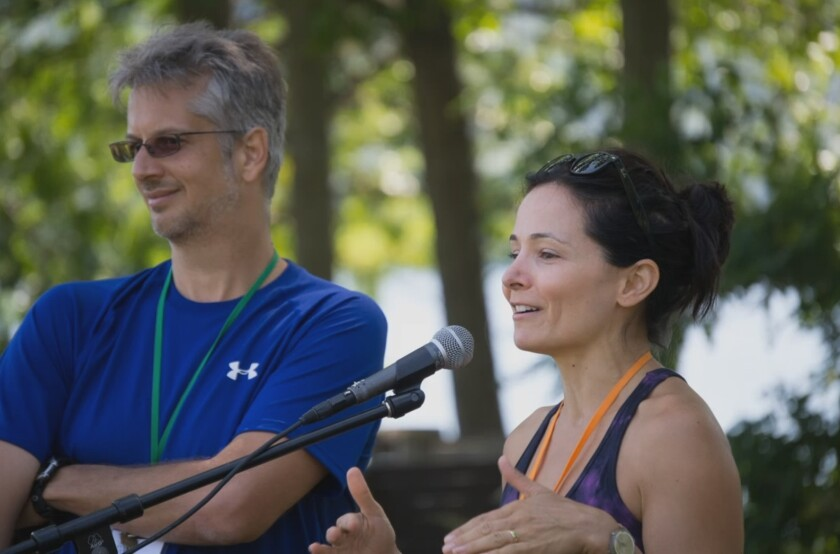 """Mark Vicente and Sarah Edmondson speak to a crowd in """"The Vow."""""""
