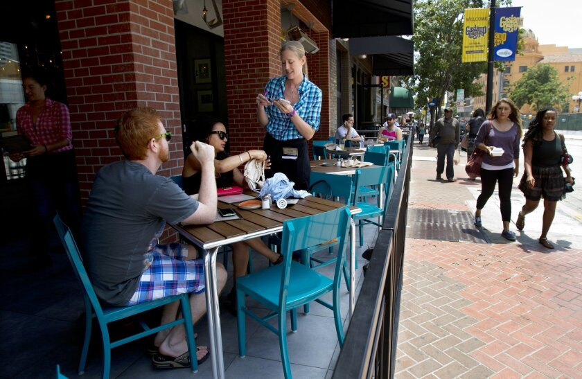 Spike Africa's in downtown San Diego was able to install a sidewalk cafe earlier this year under the existing regulations.