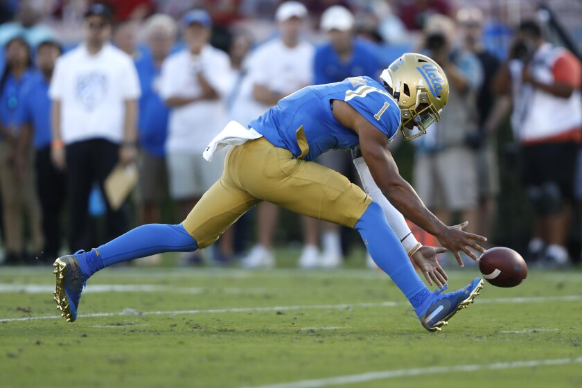 UCLA quarterback Dorian Thompson-Robinson chases a high snap during the first half of Saturday's loss to Oklahoma at the Rose Bowl.