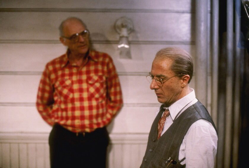 "Playwright Arthur Miller (1915-2005), left, talks to actor Dustin Hoffman during production of the CBS adaptation of ""Death of a Salesman,"" broadcast in 1985."